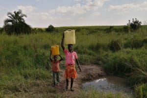 The Water Project: Nsamya Nusaff II Well -  Carrying Water