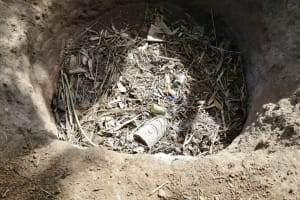 The Water Project: Nsamya Nusaff II Well -  Garbage Pit