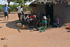 The Water Project: Nsamya Nusaff II Well -  People Chatting Together