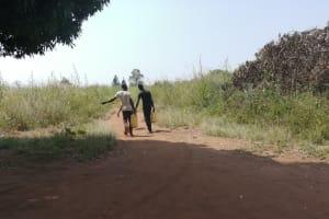 The Water Project: Rwenziramire Community -  Children Carry Water Home