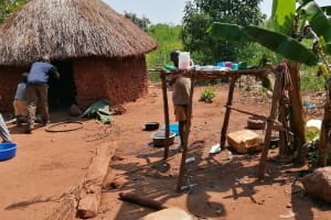 The Water Project: Rwenziramire Community -  Kitchen With Dish Rack Outside