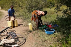 The Water Project: Rwenziramire Community -  Washing Clothes Near The Open Source
