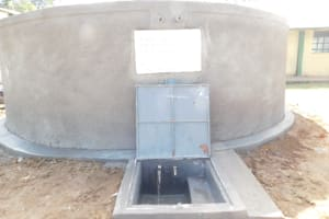The Water Project: Eshimuli Primary School -  Water Flowing From Finished Tank