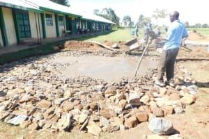 The Water Project: Eshimuli Primary School -  Laying Rain Tank Foundation