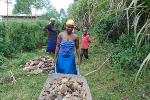 The Water Project: Mukhungula Community, Mulongo Spring -  Delivering Rocks To Spring Site
