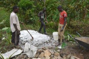 The Water Project: Mukhungula Community, Mulongo Spring -  Mixing Cement