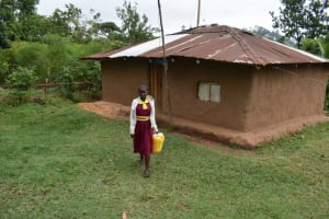 The Water Project: Givudemesi Primary School -  Nelly Leaves Home To Fetch Water Before School