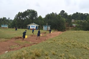 The Water Project: Kabinjari Primary School -  Rushing To Get Water