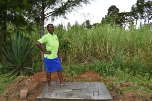 The Water Project: Kimang'eti Community, Kimang'eti Spring -  Redempta Poses On Her New Sanitation Platform
