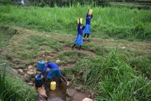 The Water Project: Gimomoi Primary School -  Collecting Water From The Spring