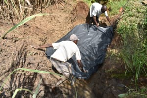 The Water Project: Musango Commnuity, Wabuti Spring -  Laying The Foundation Sheet