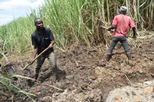 The Water Project: Musango Commnuity, Wabuti Spring -  Leveling The Area With Soil