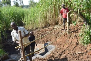 The Water Project: Musango Commnuity, Wabuti Spring -  Constructing A Protective Fence