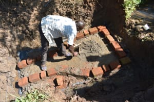The Water Project: Musango Commnuity, Wabuti Spring -  Bricklaying Begins On Top Of Foundation