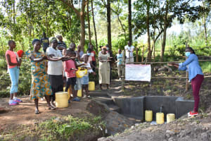 The Water Project: Shianda Township Community, Olingo Spring -  Field Officer Adelaide Hands Over The Spring To Community