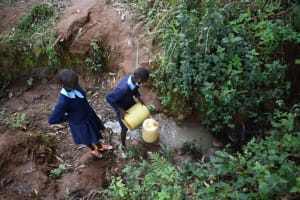 The Water Project: Kabinjari Primary School -  Students Collecting Water From An Open Source