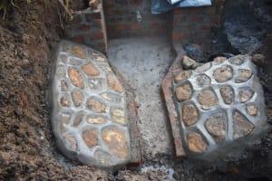 The Water Project: Musango Commnuity, Wabuti Spring -  Plastered Stone Pitching