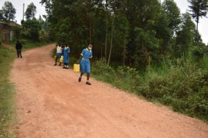 The Water Project: Gimomoi Primary School -  Carrying Water To School From Homes Source