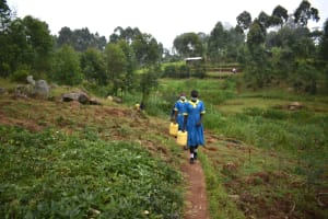 The Water Project: Gimomoi Primary School -  Pupils Going To The Spring To Fetch Water