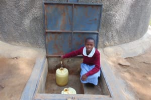 The Water Project:  Beatrice Collecting Water