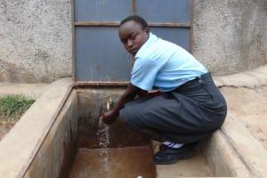 The Water Project: Chebunaywa Secondary School -  Vallary Washing Her Hands At The Rain Tank