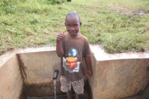 The Water Project: Mukhuyu Community, Kwakhalakayi Spring -  Timothy Gives Thumbs Up For Clean Water