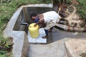 The Water Project: Maondo Community, Ambundo Spring -  Barbara Fetching Water