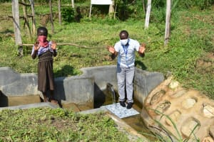The Water Project: Kalenda B Community, Lumbasi Spring -  Field Officer Victor With Shinell
