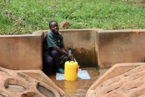 The Water Project: Kitulu Community, Kiduve Spring -  Enock Enjoying Water