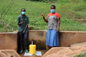 The Water Project: Kitulu Community, Kiduve Spring -  Enock And Sheila At The Spring