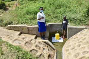 The Water Project: Tumaini Community, Ndombi Spring -  Field Officer Betty With Noah At The Spring