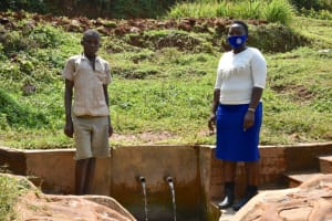 The Water Project: Munenga Community, Francis Were Spring -  Felix At The Spring With Field Officer Betty