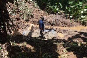 The Water Project: Shihome Community, Peter Majoni Spring -  Laying Foundation