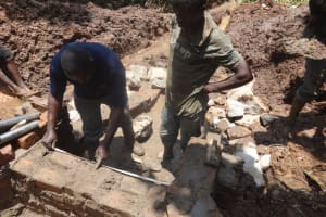 The Water Project: Shihome Community, Peter Majoni Spring -  Wall Construction