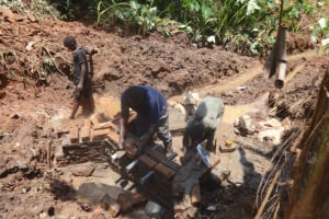 The Water Project: Shihome Community, Peter Majoni Spring -  Pipe Setting