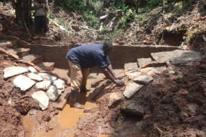 The Water Project: Shihome Community, Peter Majoni Spring -  Stone Pitching