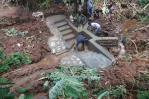 The Water Project: Shihome Community, Peter Majoni Spring -  Plastering The Spring Walls