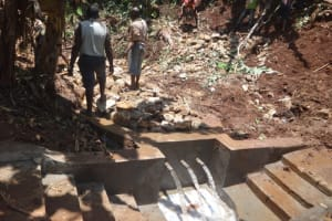 The Water Project: Shihome Community, Peter Majoni Spring -  Clear Water Beings To Flow During Backfilling