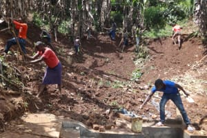 The Water Project: Shihome Community, Peter Majoni Spring -  Soil Backfilling Over Tarp