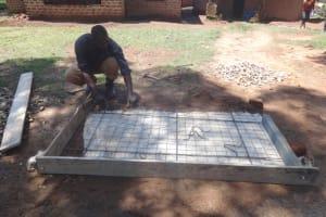 The Water Project: Shihome Community, Peter Majoni Spring -  Sanitation Platform Construction