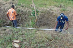 The Water Project: Machemo Community, Boaz Mukulo Spring -  Taking Spring Measurements