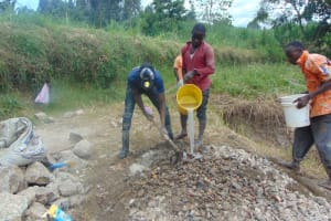 The Water Project: Machemo Community, Boaz Mukulo Spring -  Mixing Concrete