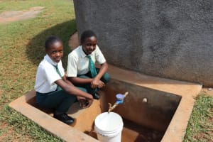 The Water Project: Green Mount Primary School -  Stephanie And Her Friend Collecting Water