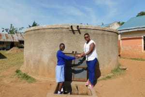 The Water Project: Lumakanda Township Primary School -  Field Officer Jacklyne And Natasha Posing At The Tank