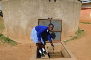The Water Project: Lumakanda Township Primary School -  Natasha Posing At The Tank