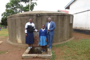 The Water Project: Lwakhupa Primary School -  Field Officer Betty With Lavinah And Teacher Walter Nasoko
