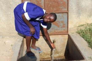 The Water Project: Musango Primary School -  Cecilia At The Rain Tank