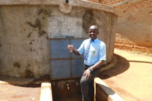 The Water Project: Immaculate Heart Secondary School -  Fredrick Holds Up A Glass Of Clean Water From The Rain Tank