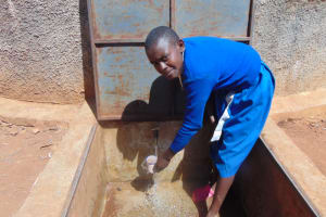 The Water Project: Sango Primary School -  Pauline Gets A Drink Of Clean Water