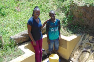 The Water Project: Malava Community, Ndevera Spring -  Field Officer Masinde And Leon